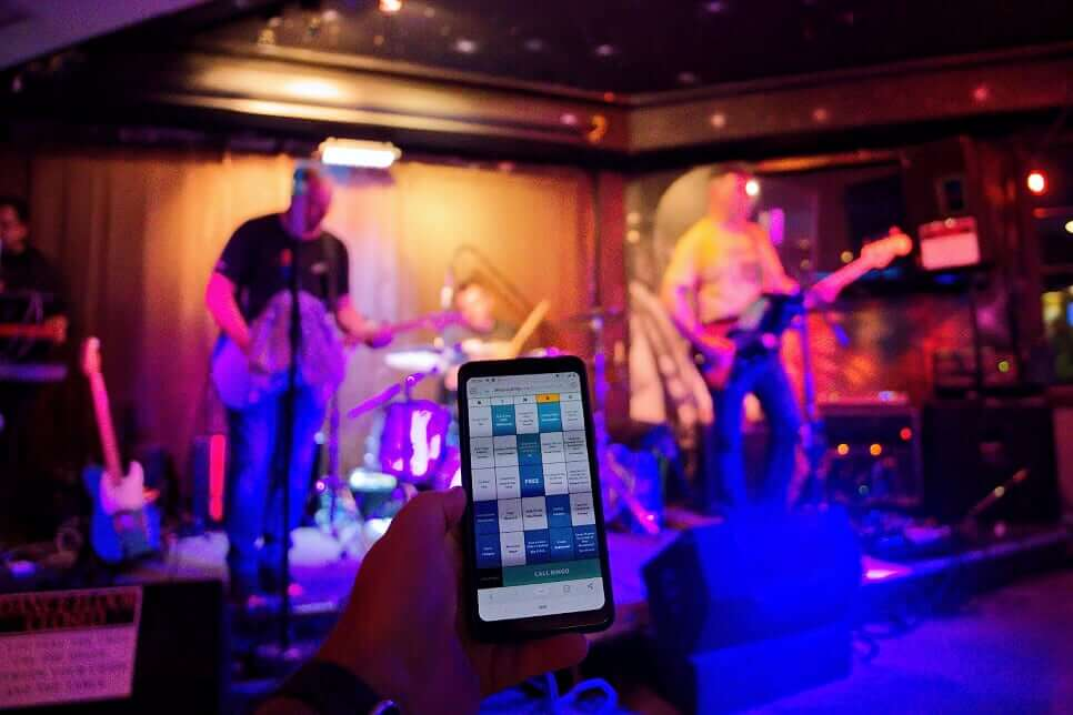 Rockstar Bingo being played on a mobile phone with a live band